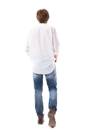 Side view of walking young sad man looking down concerned with bowed head. Full body length isolated on white background. Zdjęcie Seryjne