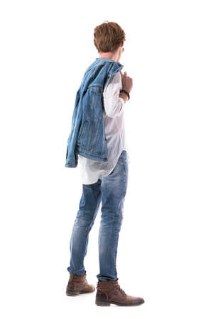 Side view of red hair man in jeans turning head looking down. Full body isolated on white background.