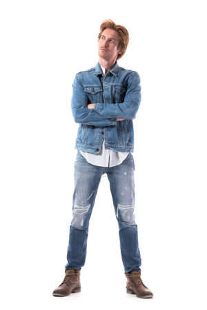 Confident serious young stylish redhead man with crossed hands looking up. Imagination. Full body isolated on white background.