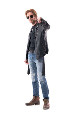 Stylish handsome cool macho rocker man showing heavy metal horns hand sign. Full body isolated on white background.