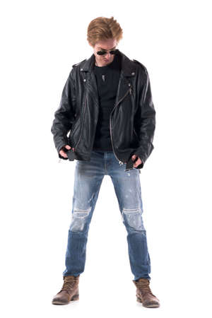 Stylish biker or rock subculture man put on leather jacket getting dressed. Full body isolated on white background.