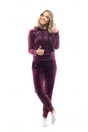 Happy casual girl in leisure wear clothes showing thumbs up with two hands. Full length isolated on white background.