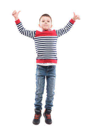 Jumping excited little boy in mid air celebrating success or victory. Full body portrait isolated on white background. Banque d'images