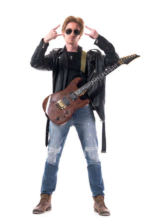 Cool macho stylish rock musician with electric guitar showing hard rock horn hand sign. Full body isolated on white background.
