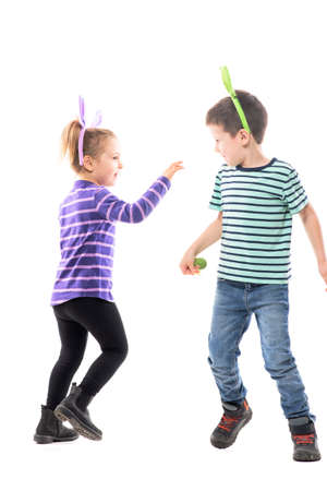 Playful happy boy and girl with Easter bunny hats playing and chasing running in circle. Full body isolated on white background