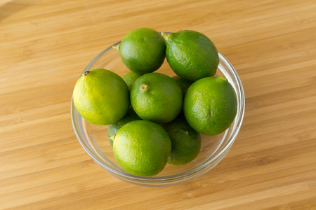 Lime on wood background Banco de Imagens