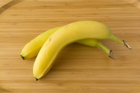 Banana on wood background