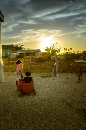 Kids playing in the beautiful sunset, in the Arizona desert.
