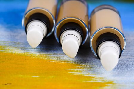 skin tones: Bottle of liquid foundation on colorful background.