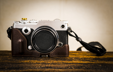 Digital camera on wooden background. Camera.