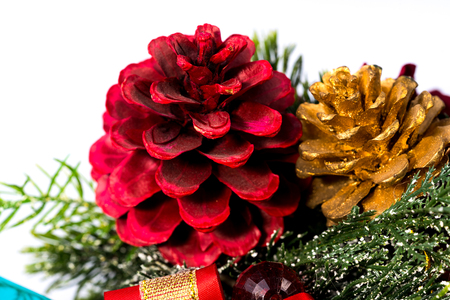 Christmas decoration  with color balls, golden pine cone, red pine cone, color gift box on white background. Christmas decoration. Stock Photo