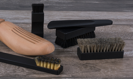 Shoes cleasning tools on wooden background./ Shoes cleansing tools. Zdjęcie Seryjne