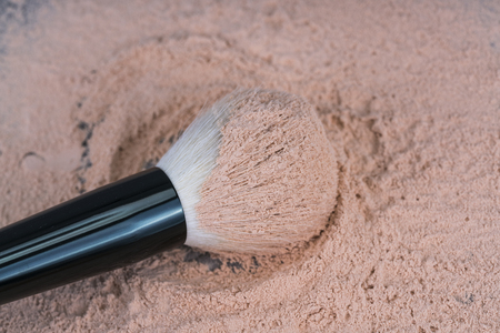 Loose powder with brush. Loose powder