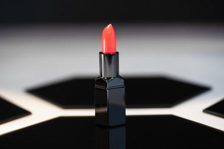 Pink lipstick bar and reflection
