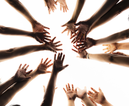 Hands together on white background Stock Photo
