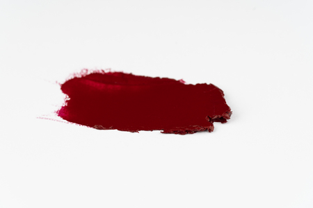 Lipstick smear in red color on white background