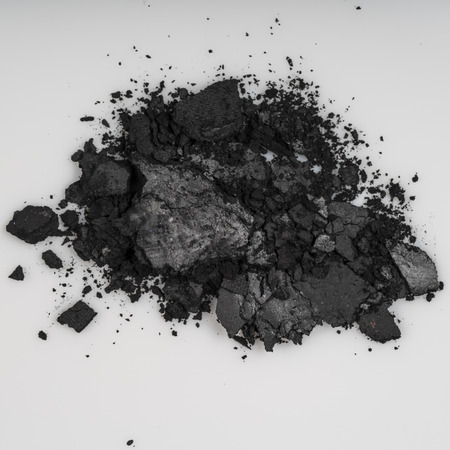 Broken eye shadow powder on white background Stock Photo