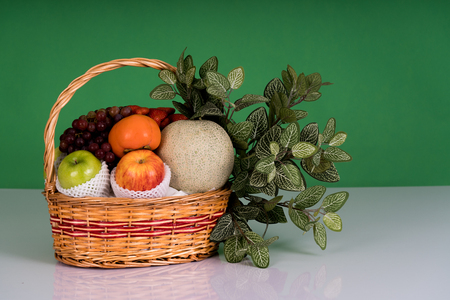 multiple fruits include apple, strawberry, grapes in the basket Stock Photo