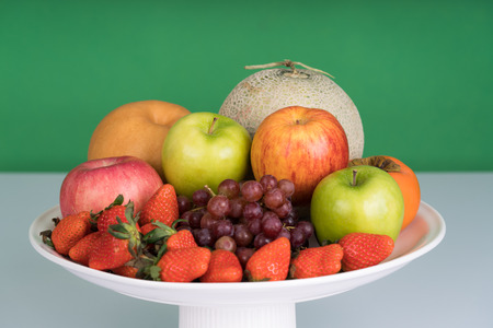 multiple fruits include apple, strawberry, grapes in the tray Stock Photo
