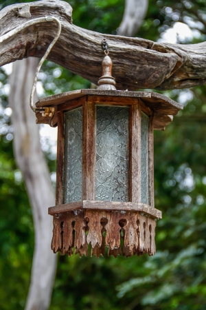 vintage wooden lamp hanging old wood in the garden  photo