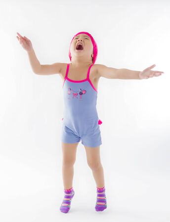 cute girl jumping with joy in swiming suit photo