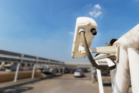 Security Camera or CCTV at car park with blue sky photo