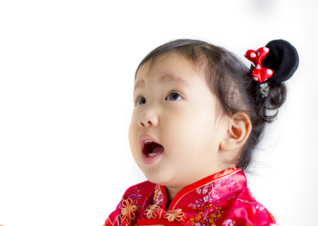 Cute child wearing red Chinese suit on white background photo