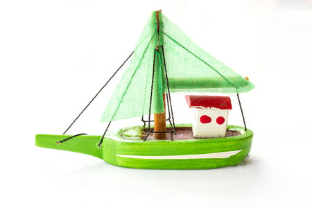 Little fishing ship model isolated on a white background  photo