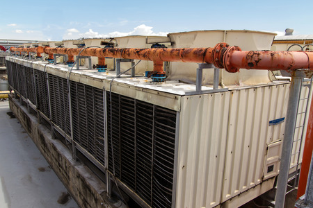 Industrial air conditioner on the roof with blue sky photo