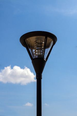 Close up of outdoor lamp with blue sky photo