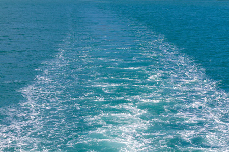 Waves of a ferry crossing the ocean in samui island, Thailand Фото со стока