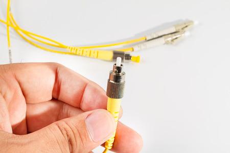 connexion: Close up of a fiber optic patchcord head