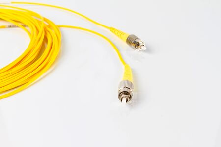 connexion: Close up of a fiber optic patchcord on white background