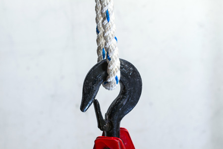 hook up: close up of heavy-duty steel hook with heavy rope