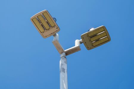 lamp post: LED street lamps post on blue sky background Stock Photo