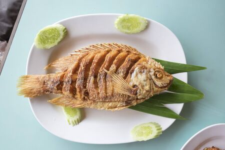 fired fish with fishsauce, fish meat