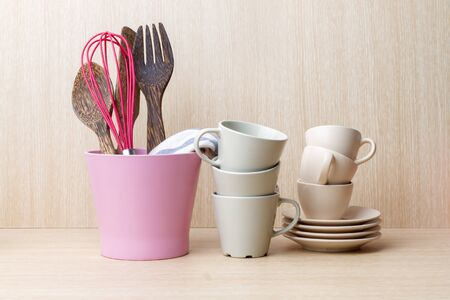 kitchen ware: Coffee cup collection with kitchen ware on wooden background Stock Photo