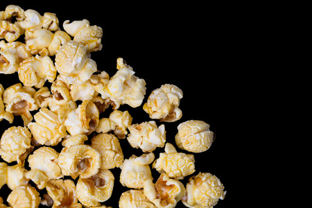 Group of Caramel Popcorn Isolated on black background, Cliping path  included. Фото со стока