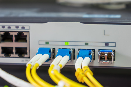plug in: optical fiber cables plug in in network switch