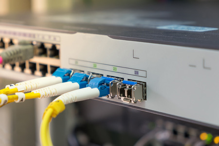 switch plug: optical fiber cables plug in in network switch