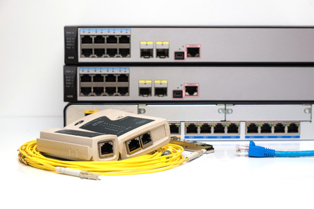fiber optic cable: Network tester on fiber optic cable, POE Network switche  background