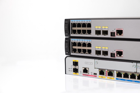 network port: Network switch front panel with 10 ports and uplink port, Close up Stock Photo