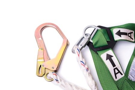 fall arrest: Closeup fall protection harness and lanyard for work at heights on white background.Closeup at safety hook. Stock Photo