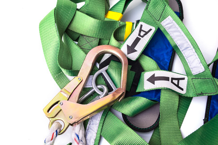 Closeup fall protection harness and lanyard for work at heights on white background.Closeup at safety hook. Standard-Bild