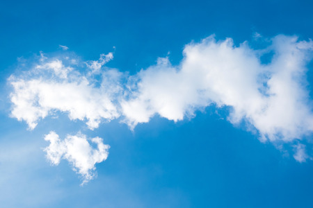 cloudscapes: blue sky with clouds and sunlight closeup Stock Photo