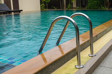 Swimming pool with stair close up Stock Photo
