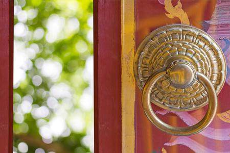 door opening: Chinese Traditional Wooden Door Opening, green bokhe of nature background.