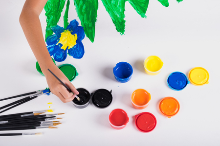 Little hand of kid learn to play colorful color on white paper Stock Photo - 77383793