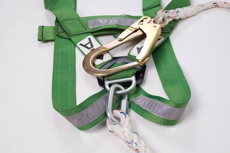 fall arrest: Closeup fall protection Hook harness and lanyard for work at heights on white background. Stock Photo