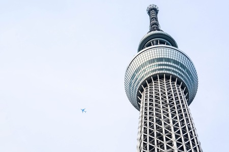 Spectacular Tokyo Skytree with an Airplane Flying in the Sky